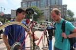 Free bike repairs were offered at the fair. David Miller (left) debriefed Ryan Smith (right) on what was causing the problem with Smith's bike.