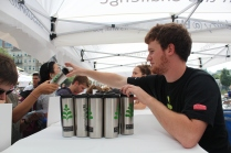 Ryan Peters, a freshman in the School of Engineering, helped give out coffee mugs provided by Sustainability@BU.